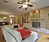 5905-paseo-del-toro-living-with-limestone-fireplace-1